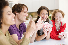 Friends Enjoying Clever Playing Cards